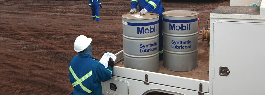 Workers Unloading Synthetic Oil Barrels